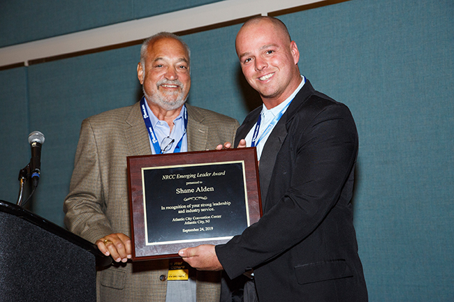 Shane Alden of Hoffman Car Wash was presented with an Emerging Leader award by Mike Benmosche.